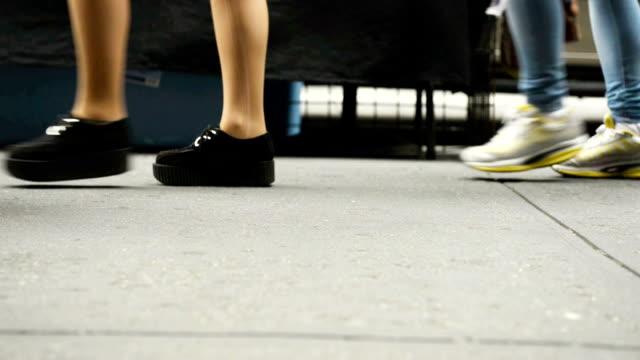 Diverse People Walking Feet Along Urban Broadway NYC Sidewalk