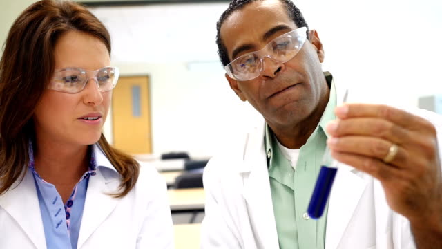 Diverse scientists confidently discuss their research