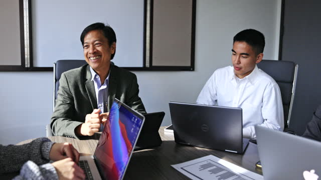 diverse staff meeting in conference room - filipino ethnicity stock videos & royalty-free footage