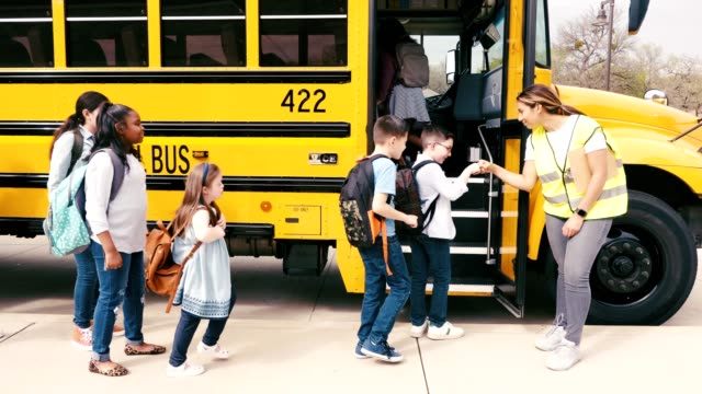 diverse students board yellow school bus - persons with disabilities stock videos & royalty-free footage