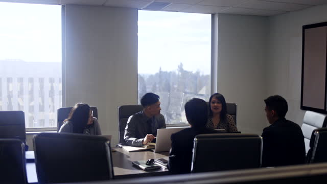 diverse team board room meeting from outside - filipino ethnicity stock videos & royalty-free footage