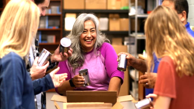 diverse team volunteering food drive - volunteer stock videos & royalty-free footage
