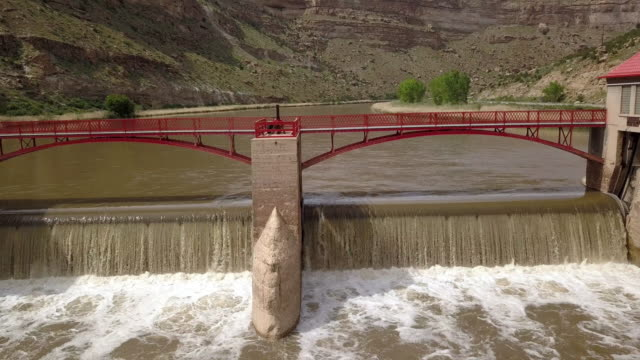 a diversion dam on the colorado river diverting water to create an irrigation canal system for farming and ranching - river colorado stock videos & royalty-free footage
