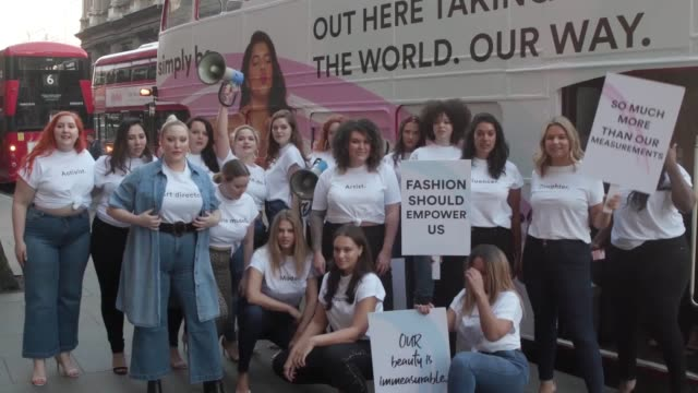 diversity campaigners arrive outside london fashion week hq on the strand to challenge the lack of size diversity in the fashion industry. - fashion industry stock videos & royalty-free footage
