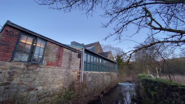 diverted river wye at caudwells mill, grade ii listed water power mill, winter, rowsley, peak district, derbyshire, england, united kingdom, europe - bare tree stock videos & royalty-free footage
