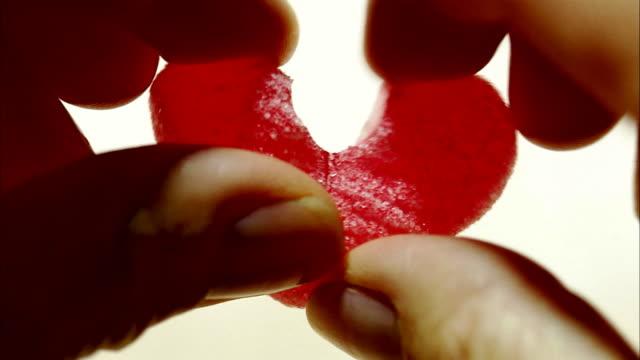 divided candy heart sweden. - okänt kön bildbanksvideor och videomaterial från bakom kulisserna