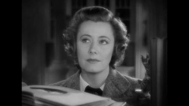1941 dividing the record collection proves to be difficult for woman (irene dunne) - grief stock videos & royalty-free footage