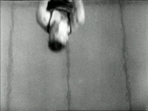 overhead diving champ pete desjardin doing jacknife off diving board / newsreel - one mid adult man only stock videos & royalty-free footage