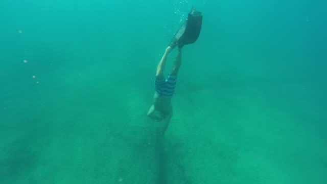 diving in the mediterranean 1 - swimming shorts stock videos & royalty-free footage