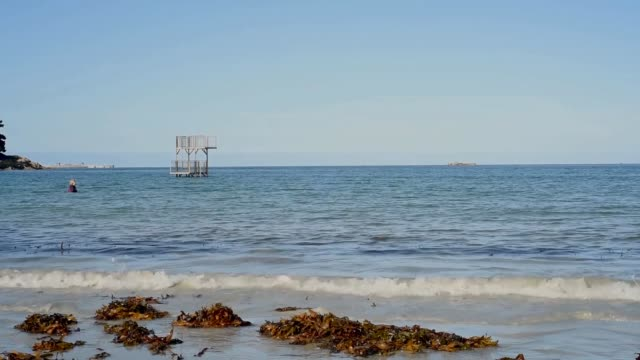 diving platform with roscoff behind, finistere - diving platform stock videos & royalty-free footage