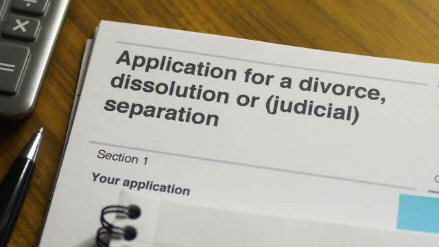 divorce, dissolution or separation application document close-up. pan l to r. - legal trial stock videos & royalty-free footage