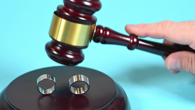 divorce sentence or wedding. two wedding rings and a judge passing sentence with his judge's gavel. - sentencing stock videos & royalty-free footage