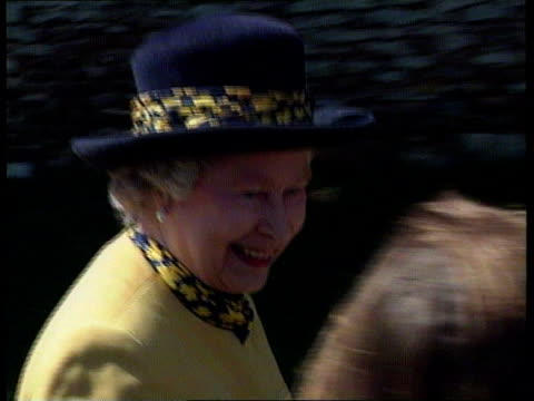 divorce settlement r21059606 itn int poundbury la ms prince charles down stairs towards pan lr sandringham seq queen along past crowd queen chatting... - prince andrew stock videos & royalty-free footage