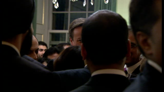 diwali celebration event at downing street; further shots of guests standing around chattign informally - including krishnan guru-murthy and keith... - krishnan guru murthy stock videos & royalty-free footage