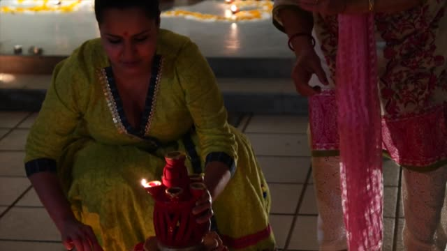 diwali is the largest and brightest ancient festival of hindus/ people dress up light up diyas or candles make rangolis participate in puja typically... - goddess stock videos and b-roll footage