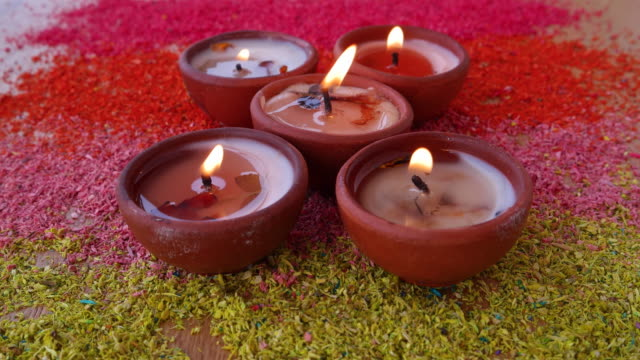Diwali preparations with colourful rangoli and lit Diyas or Indian festive lamps