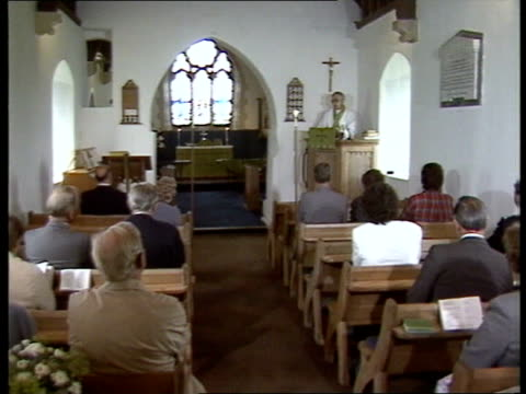 Dyfed Little Haven St Mary's Church INT Service as vicar processes to altar CMS Stained glass window detail CMS Vicar at pulpit CBV Congregation...