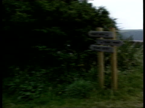 Dixon couple murder investigation ITN Dyfed Sign posts on coastal path PAN RL to spot near where Peter and Gwenda Dixon were found murdered CMS Stile