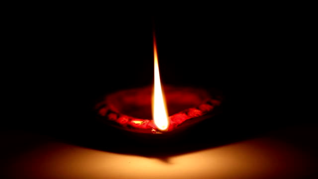 diya (oil lamp) close up - religion stock videos and b-roll footage