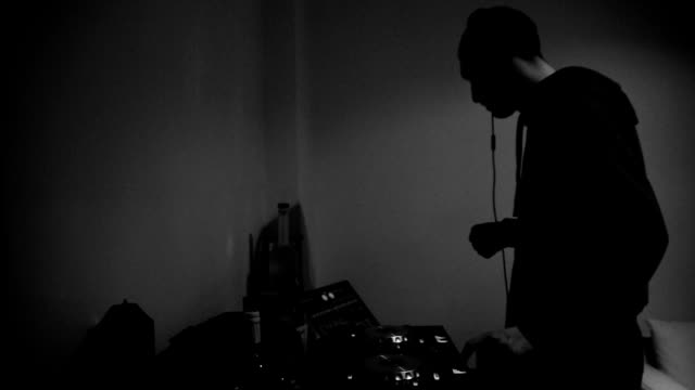 Dj playing music. Black and white