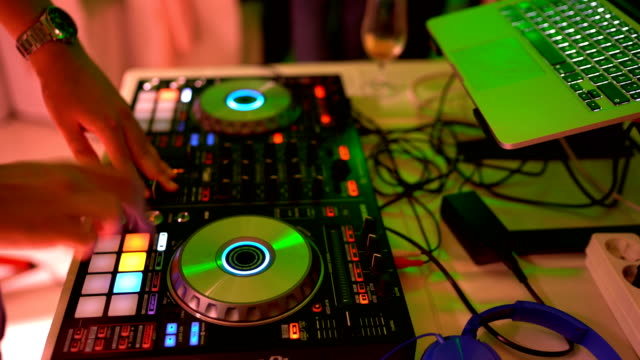 dj playing music on night party - compact disc player stock videos & royalty-free footage
