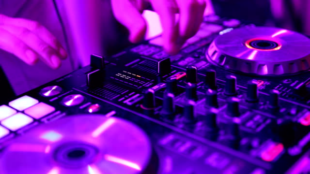 dj playing music on night party - control panel stock videos & royalty-free footage