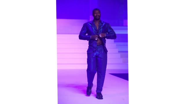 djibril cisse walks the runway during the jean-paul gaultier haute couture spring/summer 2020 show as part of paris fashion week at theatre du... - paris fashion week - haute couture spring/summer 2020点の映像素材/bロール