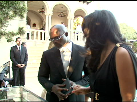 djimon hounsou and kimora lee at the cartier hosts the third annual loveday celebration at los angeles california. - occurrence stock videos & royalty-free footage