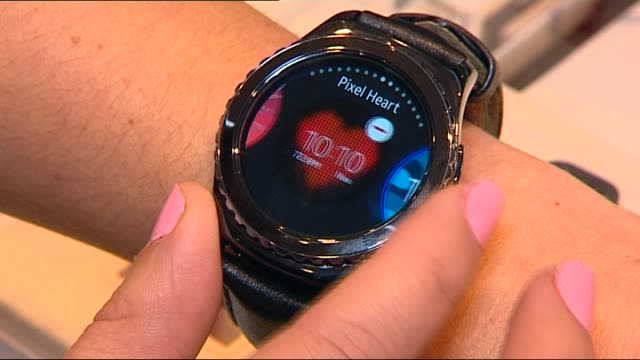 "and watch has to be round for the customer feedback that's what they tell us"" / gear s2 samsung smartwatch use / voxpop customer ""i do like the round... - wearable computer stock videos & royalty-free footage"
