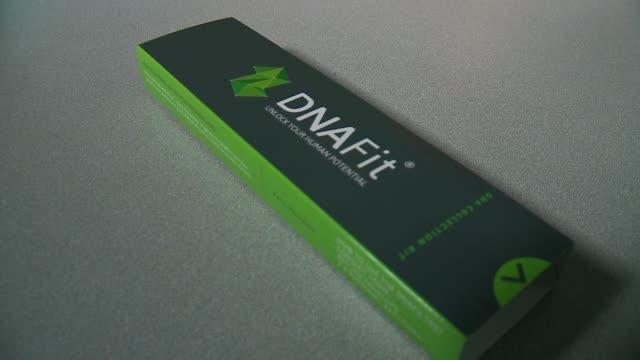 vidéos et rushes de dnafit dna testing kit box on may 10, 2017. - recherche génétique
