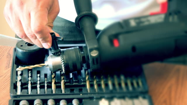 a do it yourself image, placing a drill on an electric power tool - drill bit stock videos and b-roll footage