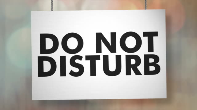 do not disturb sign hanging from ropes. luma matte included so you can put your own background. - sign stock videos & royalty-free footage