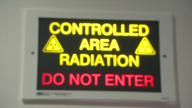 do not enter sign in hospital for controlled area of radiation - radiation stock videos & royalty-free footage
