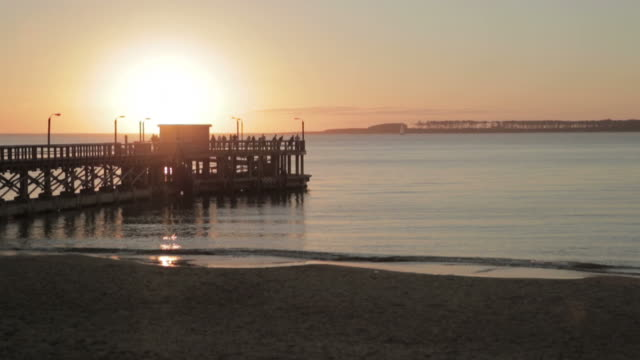 dock sunset. - uruguay video stock e b–roll
