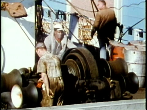 1963 MONTAGE Dock workers loading goods onto container ship / Chicago, United States / AUDIO