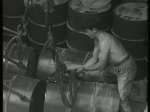 dock workers offload cargo from a ship using a crane - unloading stock videos & royalty-free footage