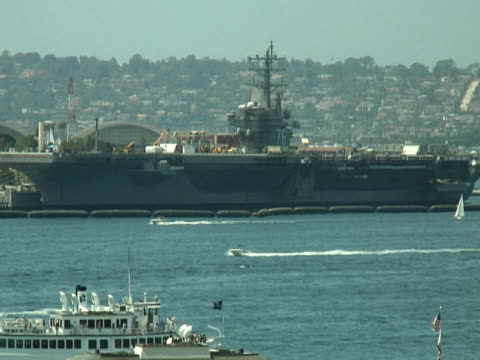 docked aircraft carrier and water traffic - aircraft carrier stock videos & royalty-free footage