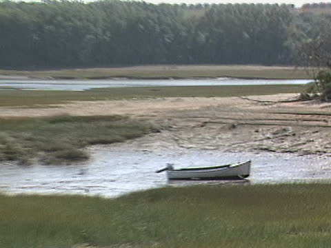 docked boats beside wharf seen in mud during low tide - low tide stock videos & royalty-free footage