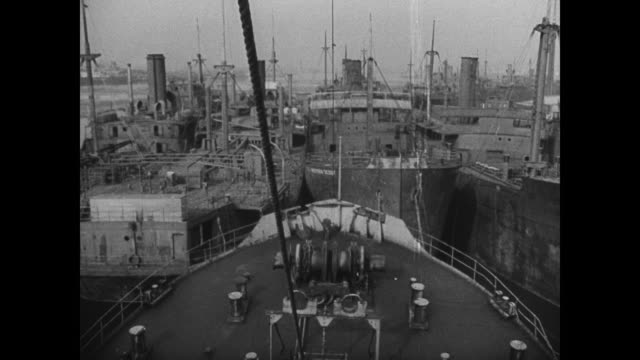 Docked oceanliner SS Leviathan VS Empty decks peeling paint VS Docked ships obsolete WWI cargo fleet