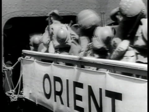 docked transport ship australian soldiers walking on ramp w/ 'orient' banner walking up gang plank troops walking along dock walking ramp into ship... - army soldier stock videos & royalty-free footage