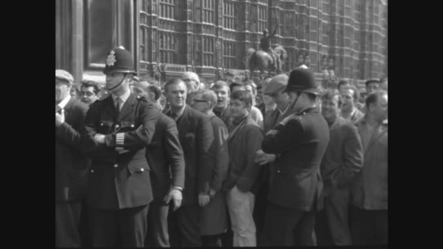 dockers protest against the sacking of enoch powell itn london houses of parliament big ben tilt down to photographers dockers towards lr bv dockers... - enoch powell stock videos & royalty-free footage
