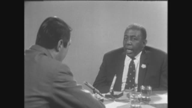 dockers protest against the sacking of enoch powell itn london studio interview with sir learie constantine on his opinion of the race bill being... - enoch powell stock videos & royalty-free footage