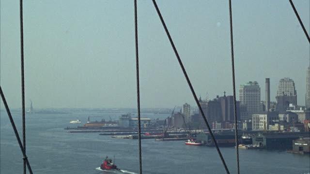 1966 WS PAN Docks and Manhattan skyline seen from Brooklyn Bridge / New York City, New York, USA