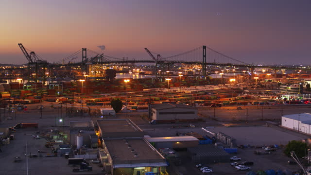 docks of the port of los angeles at dusk - drone shot - port of los angeles stock videos & royalty-free footage