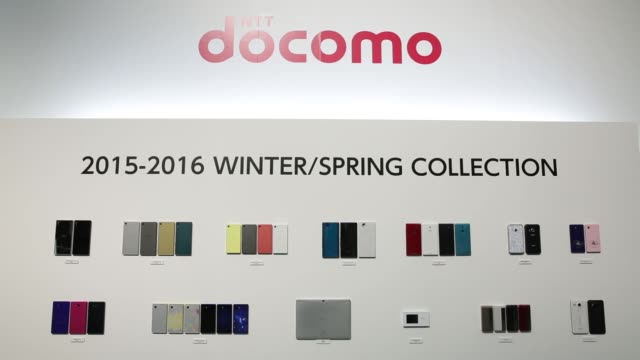 ntt docomo inc's new smartphones tablet computer mobile device and mobile phones are displayed on a wall at an unveiling in tokyo japan on wednesday... - 発表イベント点の映像素材/bロール