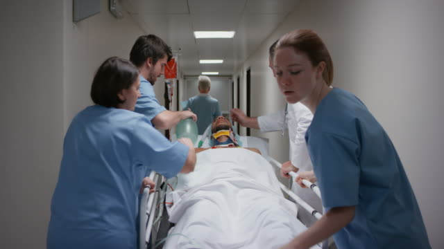 ds doctor and his medical team manually ventilating a patient on the gurney - operating room stock videos and b-roll footage