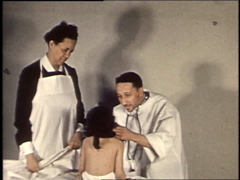 1940 montage doctor and nurse examining young girl / united states - medical supplies stock videos & royalty-free footage