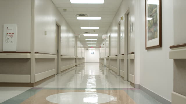 WS POV Doctor and Nurse talking and walking in hall / Houston, Texas, United States