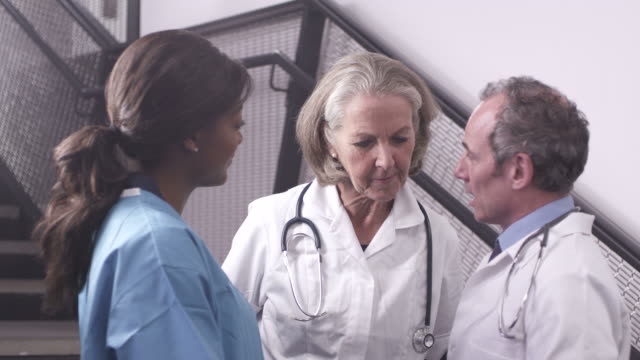 doctor and nurse using tablet - greater london stock videos & royalty-free footage
