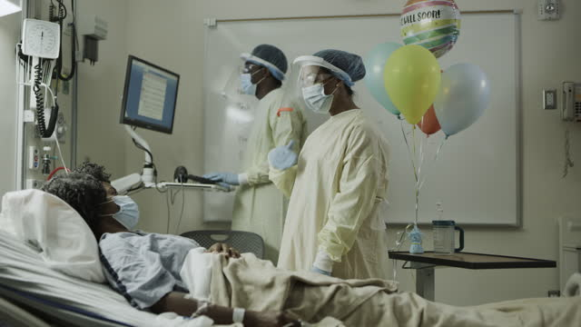 doctor and nurse wearing protective equipment checking on infectious patient / salt lake city, utah, united states - 30 39 years stock videos & royalty-free footage